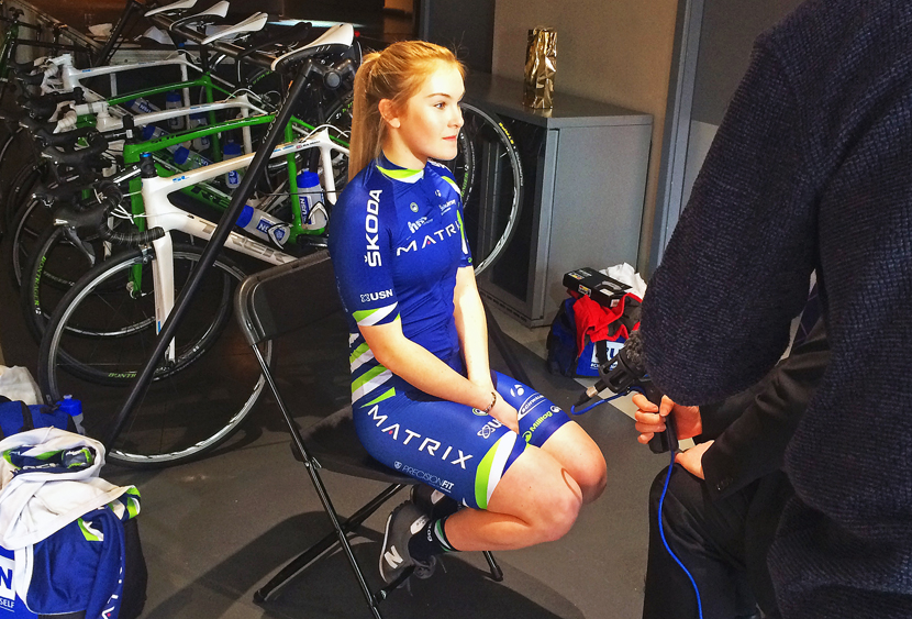 Lucy Shaw, 17 year old Development rider, interviewed in front of the team's Trek bikes.