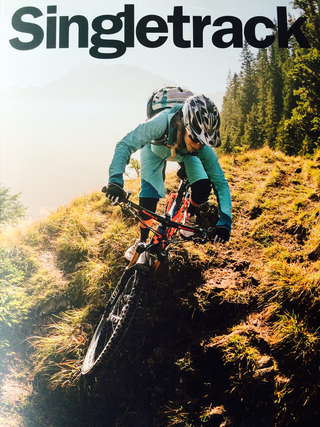 The cover of Singletrack May 2015 featuring Laura Brethauer. Image by Christoph Laue.